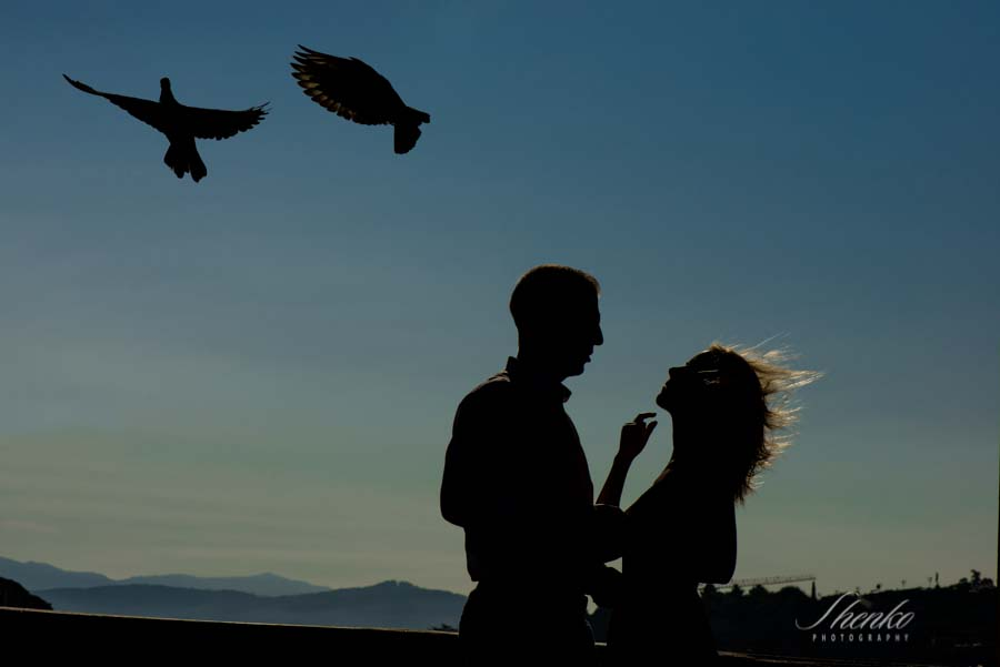 Romantic couple with pigeons in Ponte Vecchio Florence