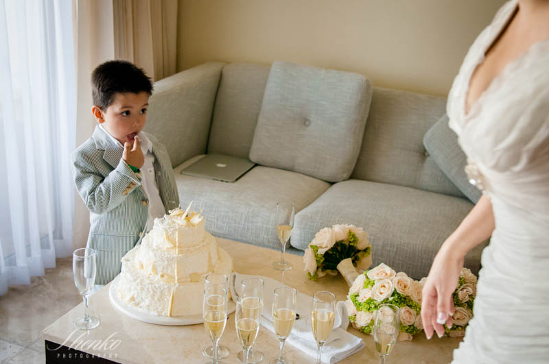 kid eating wedding cake with bride